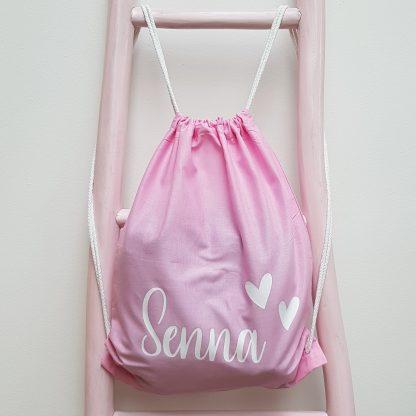 Roze katoenen gymtas naam met hartjes foto